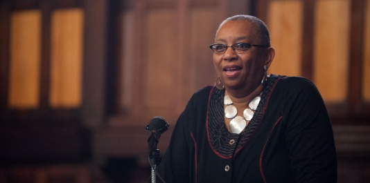 11/25/14 – Medford/Somerville, MA – Katrina Moore, Africana Center Director, speaks during a gathering in Goddard Chapel on Nov. 25 to discuss and reflect on the recent Grand Jury decision not to indict police officer Darren Wilson with any charges. (Nicholas Pfosi / The Tufts Daily)