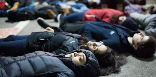 –Protesters participate in a die in at Davis Square. The march started at Tufts University and continued through Davis Square and through Cambridge to the Harvard Bridge on Friday, Dec. 5th.