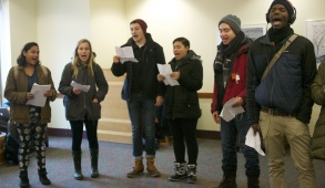 """2014-12-11- Somerville/Medford, MA -  Tufts students chant """"black lives matter"""" in the Tisch Library Reading Room to disrupt students studying to represent the way black lives have been disrupted by recent tragedies across America. (Sofie Hecht / The Tufts Daily)"""