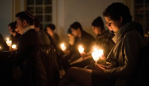 Members of the Tufts community join together in a candlelit moment of silent reflection during the Tufts Vigil for Love and Remembrance in the Interfaith Center on February 13th, 2015. This event follows the triple homocide of Yusor Mohammad Abu-Salha, her husband Deah Barakat, and her sister Razan Mohammad Abu-Salha. (Nicholas Pfosi / The Tufts Daily)