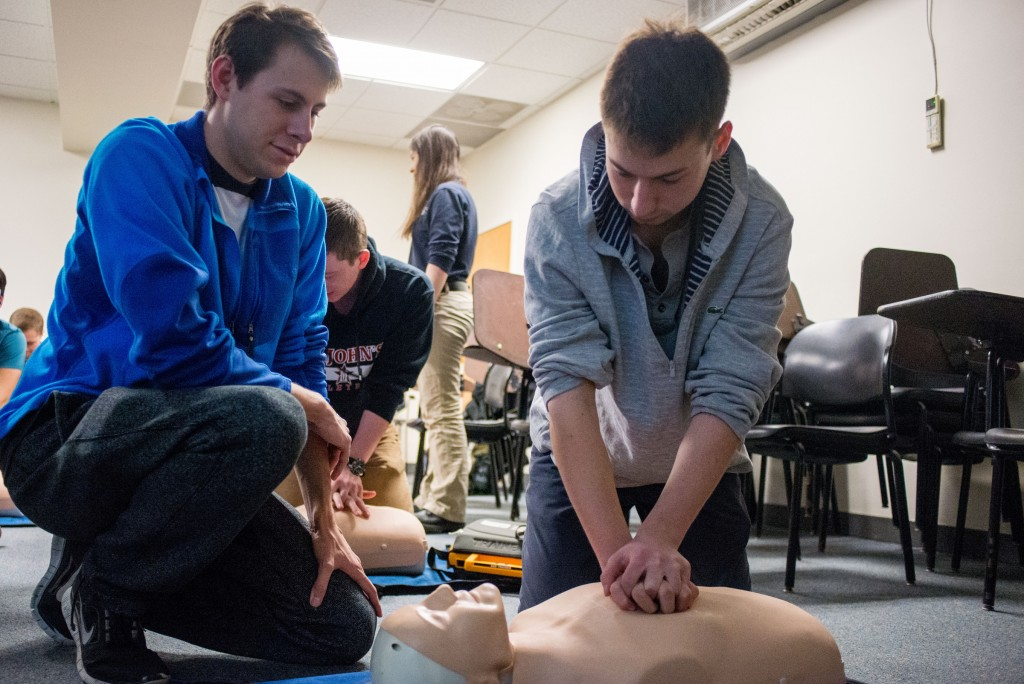 Members of the Tufts community participate in a TEMS CPR Certification class in Jackson Hall on Saturday, Mar. 7, 2015. The Tufts Emergency Medical Service (TEMS) has trained nearly 800 community members earning their campus a HeartSafe certification during the National Collegiate EMS Foundation Conference in Baltimore, MD.  (Nicholas Pfosi / The Tufts Daily)