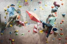 Two members of the Climbing Team boulder at MetroRock on Tue. March 24, 2015. (Evan Sayles / The Tufts Daily)