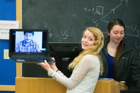 TCU Elections Committee chair Paige Newman holds a laptop with a Skype connection to presidential nominee Brian Tesser on Tuesday, Apr. 14, 2015. Tesser, currently abroad in Spain, accepted the nomination over Skype. (Evan Sayles / The Tufts Daily)