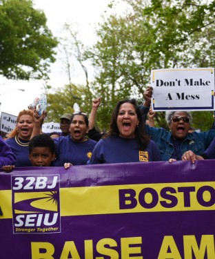 Service Employees International Union 32BJ holds a march from Powderhouse Square to campus on May 16 to protest planned janitorial cuts.