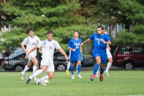 Tufts sophomore midfielder Tyler Kulcsar keeps the ball from Colby in their 2-0 victory on Sept. 12, 2015.