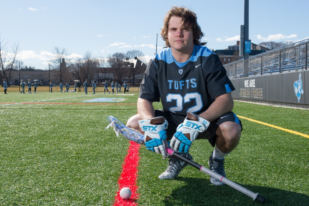 Tufts midfielder Conor Helfrich, Major League Lacrosse draft for the Denver Outlaws, poses for a portrait on Bello Field on Friday, Feb. 26. (Evan Sayles / The Tufts Daily)