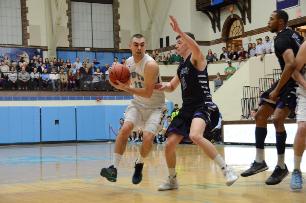 senior tri-captain guard Stephen Haladyna competes against an Amherst player in the NCAA quarter finals on March 12. (Laura de Armas / The Tufts Daily)