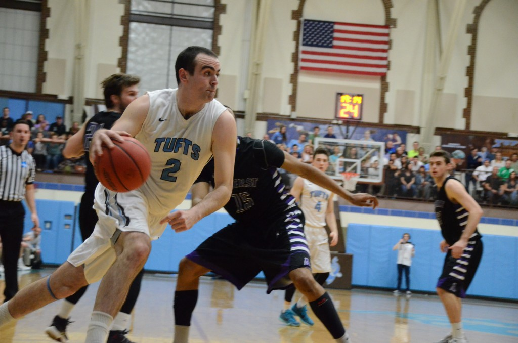 Tufts tri-captain center Tom Palleschi (LA'17) drives the ball down the court on the NCAA quarter finals game against Amherst on March 12. (Laura de Armas / The Tufts Daily)