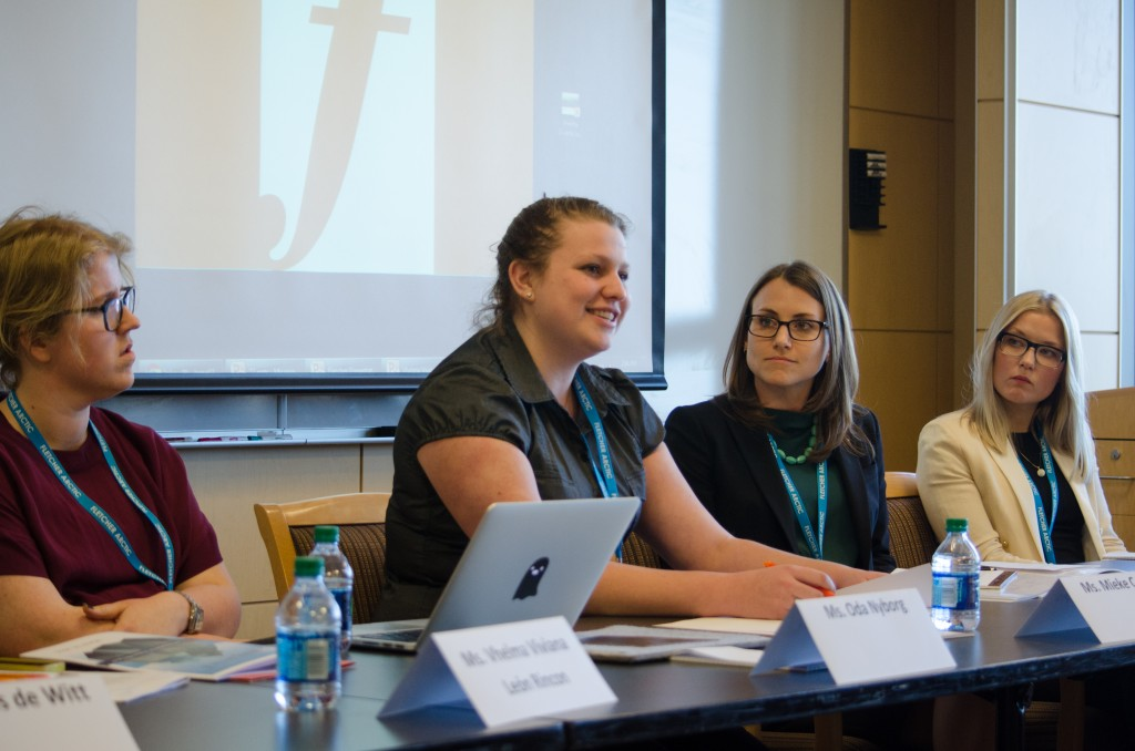 Mieke Coppes (center left) discusses her research on the role of the Inuit Circumpolar Council and their influence on arctic foreign policy. (Alex Knapp / The Tufts Daily)