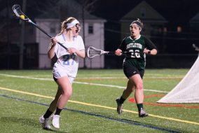 3/7/16 – Medford/Somerville, MA – Tufts attacker Dakota Adamec (LA '19) looks for a teammate in front of the Castleton net in a game on Monday, March 7. (Evan Sayles / The Tufts Daily)