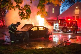 Firefighters extinguish a car fire in the parking lot of the Tufts University Health Service on Monday, May 9, 2016. (Evan Sayles / The Tufts Daily)