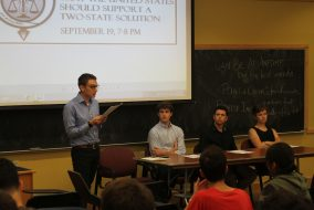 """Sophomore Andrew Goldblatt speaks during the first Tufts Union Debate event, """"This Campus Believes that the U.S. Should Support a Two-State Solution"""" in Braker 001 on Sept. 19. (Kevin Ho / The Tufts Daily)"""