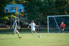 Before a Lesley defender moves in, Tufts back Taylor Koscho, '19, moves to kick the ball down the field on Wednesday, Sep. 9, 2015. (Evan Sayles / The Tufts Daily)