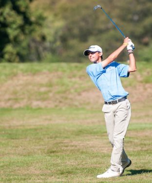 Junior tri-captain Aaron Corn hits the ball for his second shot of the seventh hole at the Newbury Invitational on Wednesday, Sept. 23, 2015. (Evan Sayles / The Tufts Daily)