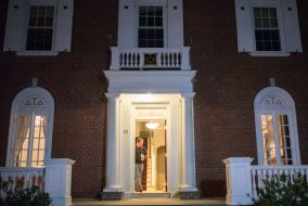 The door at 98 Professors Row lies ajar on Wednesday, March 9, when a board of the fraternity's alumni met to discuss the future of the house. (Evan Sayles/The Tufts Daily Archive)