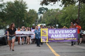 Tufts Labor Coalition members march alongside janitors on the Class of 2020's Matriculation Day, Aug. 31. (Max Lalanne/The Tufts Daily)