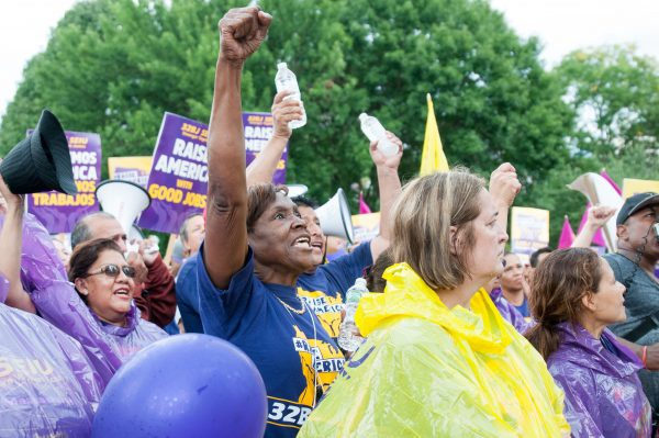 Members of 32BJ SEIU stand at Parkman Bandstand in Boston, Mass. on Saturday, Sept. 10, 2016. 32BJ SEIU, an affiliate of the Service Employees International Union, is the largest union of property service workers in the U.S. The union will renegotiate for a contract later this month. (Evan Sayles / The Tufts Daily)