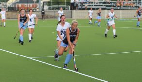 First-year forward Shannon Yogerst evades Wellesley player to maintain possession in the game against Wellesley on Sept. 20. (Sitara Rao / The Tufts Daily)