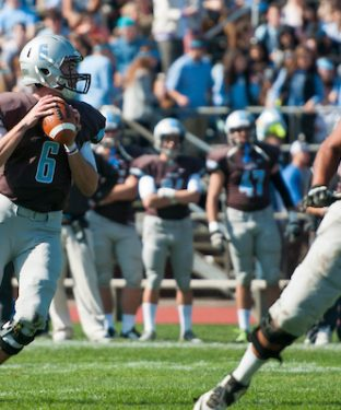 Senior quarterback Alex Snyder looks for an open player to catch his pass in the homecoming game against Bowdoin on Oct. 10, 2015. (Evan Sayles / The Tufts Daily)