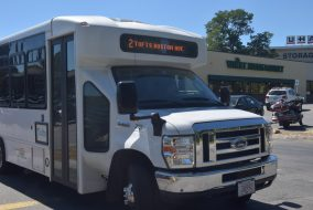 The Tufts Boston Avenue Shuttle stopping by on its new stop at Whole Foods Market. (Thaw Htet / The Tufts Daily)