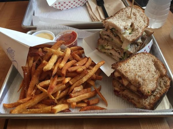 Pommes frites, cookie butter sandwich, and herb roasted chicken sandwich