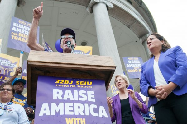 32BJ SEIU Executive Vice President Larry Engelstein speaks at Parkman Bandstand in Boston, Massachusetts with Sen. Elizabeth Warren (D-MA) and 32BJ SEIU Vice President Roxana Rivera on Saturday, Sept. 10. (Evan Sayles / The Tufts Daily)