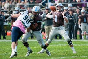 – Tufts quarterback senior is protected by running back senior Chance Brady, as he prepares to pass the ball in the game against Trinity on Saturday, Oct. 17, 2015. (Evan Sayles / The Tufts Daily)