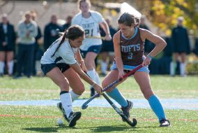 Senior forward Dominique Zarrella plays the ball in a game against Trinity on Oct. 31, 2015. (Evan Sayles / The Tufts Daily Archive)