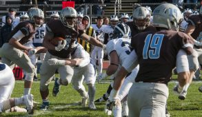 11/14/2015 - Medford/Somerville, MA - Tufts senior co-captain running back Chance Brady cuts right during Tufts' mens' football team's 31-28 victory against Middlebury at a home game on Ellis Oval/Zimman Field on November 14th, 2015.  (Ray Bernoff/The Tufts Daily)