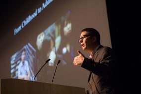 "Roberto Gonzales, author of the Class of 2020 Common Reading Book ""Lives in Limbo: Undocumented and Coming of Age in America,"" speaks in Cohen Auditorium on Oct. 6. (Max Lalanne / The Tufts Daily)"