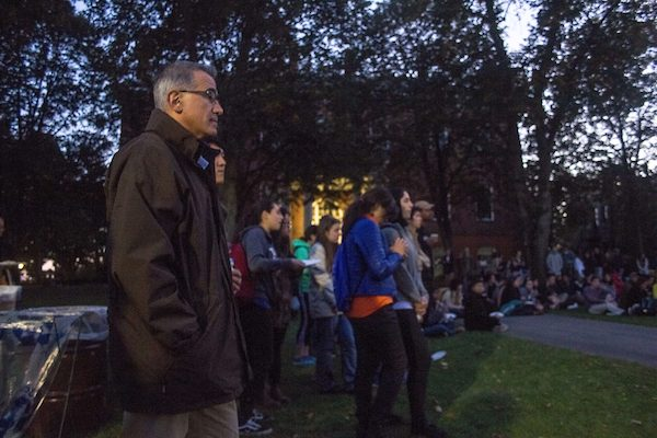 University President Anthony Monaco watches the performances on the Academic Quad during the Indigenous People's Day Celebration at Tufts on Oct. 10. (Max Lalanne / The Tufts Daily)
