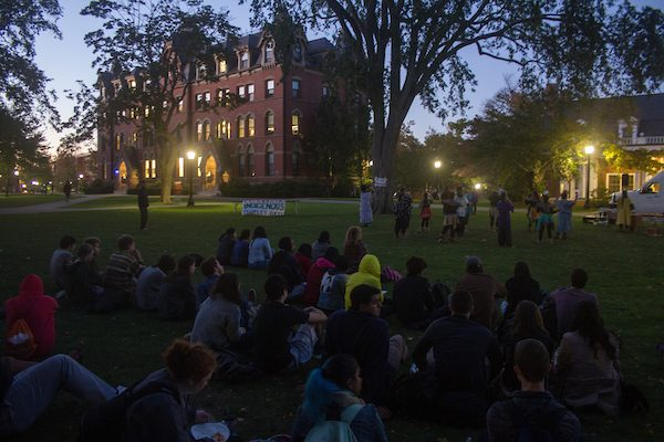 Students gather on the Academic Quad to watch Indigenous dancers perform in the Indigenous People's Day Celebration at Tufts on Oct. 10. (Max Lalanne / The Tufts Daily)