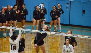 Sophomore outside hitter / opposite Mackenzie Bright prepares to spike the ball past Springfield blockers in the home game at Cousens Gym on Oct. 21. (Zach Sebek / The Tufts Daily)