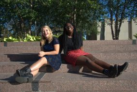 Sophomores and Damsels co-founders Chopper Carter-Schelp (left) and Kriska Desir (right) pose for a picture on Tisch Roof on Oct. 3. (Thaw Htet / The Tufts Daily)