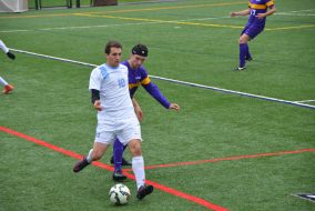 Senior forward Gaston Becherano passes the ball to his teammate in the game against Williams on Oct. 22.  (Zach Sebek / The Tufts Daily)