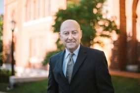 James Stavridis, dean of the Fletcher School, poses for a portrait in front of Fletcher on Oct. 12. (Colin Murphy / The Tufts Daily)