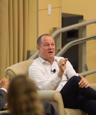 "Art Peck, CEO of Gap Inc. speaks during IBGC Speaker Series' ""Minding the Gap: The Art of Sustainable Leadership"" discussion, moderated by Senior Associate Dean of the Fletcher School  Bhaskar Chakravorti, in ASEAN Auditorium on Oct. 19. (Max Lalanne / The Tufts Daily)"