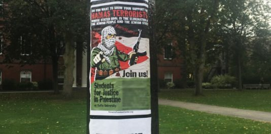 Three of the Horowitz center's flyers, pictured on a pole outside of Bendetson hall. The poster in the center lists the names of individuals associated with Students for Justice in Palestine, which have been blurred for their privacy. (Courtesy Miriam Israel)