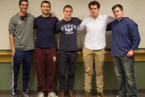 The executive members of the Interfraternity Council (from left to right junior Jack Friend, junioe Jack Benoit, RMAT Founder Rob Jacobson (LA'16), IFC President Alex Spring and senior Sam Berzok pose for a picture in Olin Hall on Nov. 10, 2015, where they discussed the implementation of the new Risk Management Assessment Team (RMAT) that will seek to keep fraternity events safer. (Sofie Hecht / The Tufts Daily Archive)