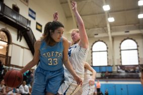 Junior forward Melissa Baptista collides with Hamilton guard and forward junior Lauren Getman during the first half of the Jan. 16 game in Cousens Gym on Jan. 16, 2016. (Nicholas Pfosi / The Tufts Daily)