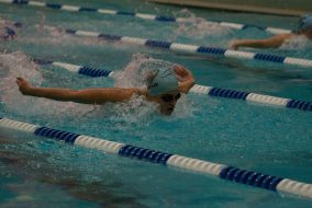 Then first-year Colleen Doolan swims butterfly in a dual meet against Wheaton College on Jan. 23. (Julia Press / The Tufts Daily Archives)