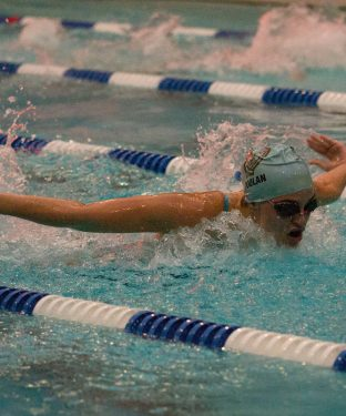 Then first year Colleen Doolan swims butterfly for the Swimming & Diving team as it faces off against Wheaton on Jan. 23. (Julia Press / The Tufts Daily Archives)