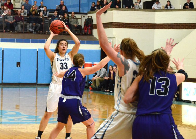 Tufts junior forward Melissa Baptista looks to pass the ball to senior tri-captain forward/center Michela North in the women's basketball game against Amherst on Feb. 28. (Laura de Armas / The Tufts Daily Archives)