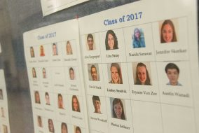 Photos of the Civil and Environmental Engineering majors in the Class of 2017 are featured on the wall in Anderson Hall on Nov. 15. (Max Lalanne / The Tufts Daily)