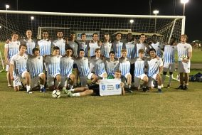 The Tufts University Football Club poses for a picture at the National Intramural and Recreational Sports Association (NIRSA) Championships, which were held in Foley, AL. from Nov. 17-19. (Courtesy Tufts University Football Club)