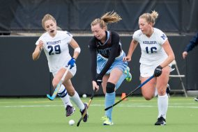 Junior forward Mary Travers fights two Middlebury players over possession of the ball in the NESCAC championship game against the Panthers on Nov. 6. (Evan Sayles / The Tufts Daily)