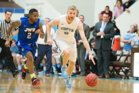 Tufts guard junior Ben Engvall races to recover the ball in the NCAA Sweet 16 tournament game against Johnson and Wales University on March 11. (Evan Sayles / The Tufts Daily)