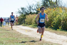 Senior Tim Nichols runs in first place at the Connecticut College Cross Country Invitational at Harkness Memorial State Park on Oct. 15. (Evan Sayles / The Tufts Daily)