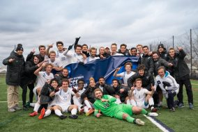 The men's soccer team poses for a photo after the quarterfinal round of the NCAA Div III men's soccer tournament on Nov. 20. (Evan Sayles for Tufts Athletics)