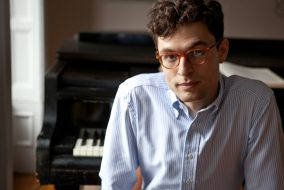 Brooklyn-based composer and pianist, Timo Andres, poses for a photo at his piano on May 2013. (Michael Wilson)